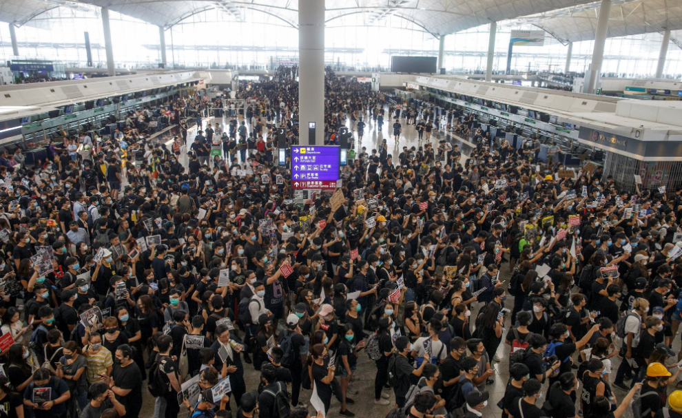 100s Of Flights Cancelled As Protesters Flood Hong Kong Airport; Chinese Troops Gather In Shenzen