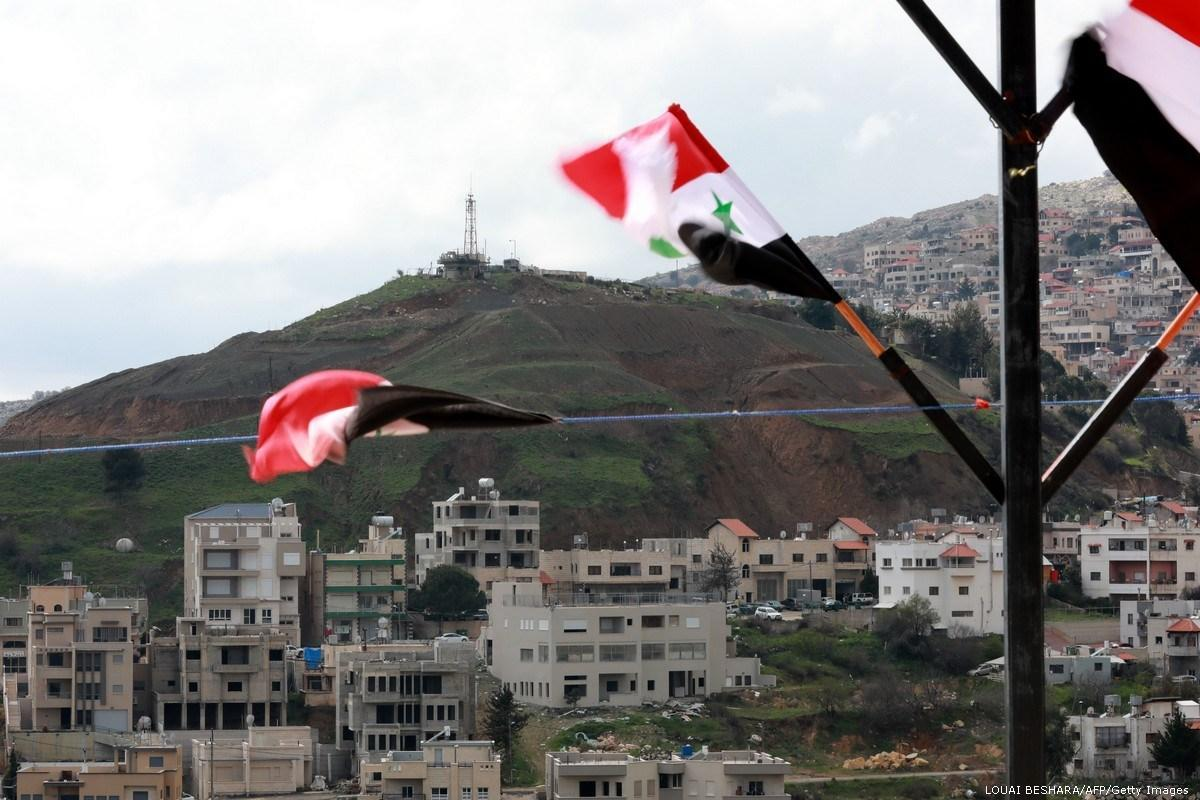 #23 - Main news thread - conflicts, terrorism, crisis from around the globe - Page 32 Syrian-national-flags-are-flown-in-golan-hieghtsGettyImages-1132913127