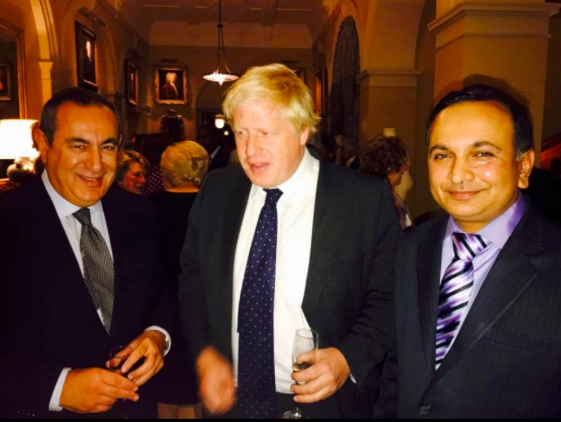 Boris Johnson pictured at the dinner with the 'London professor', Joseph Mifsud (left) and Prasenjit Kumar Singh.